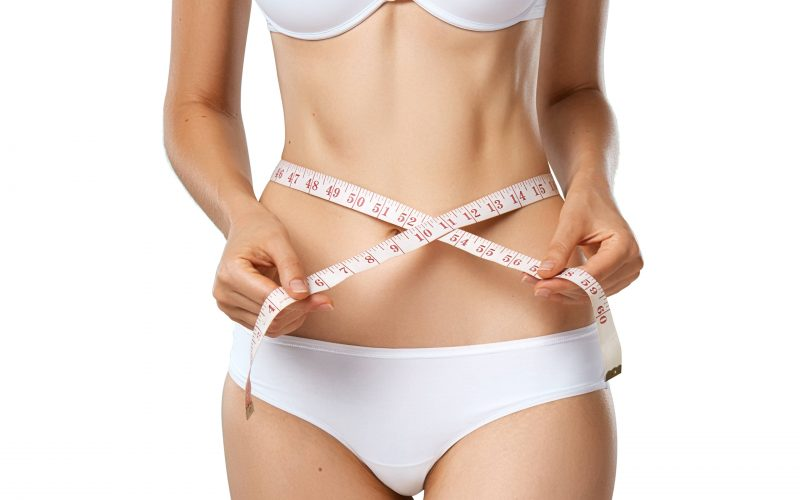 slim-tanned-woman-with-measure-tape-around-waist-CVRYLWT-min